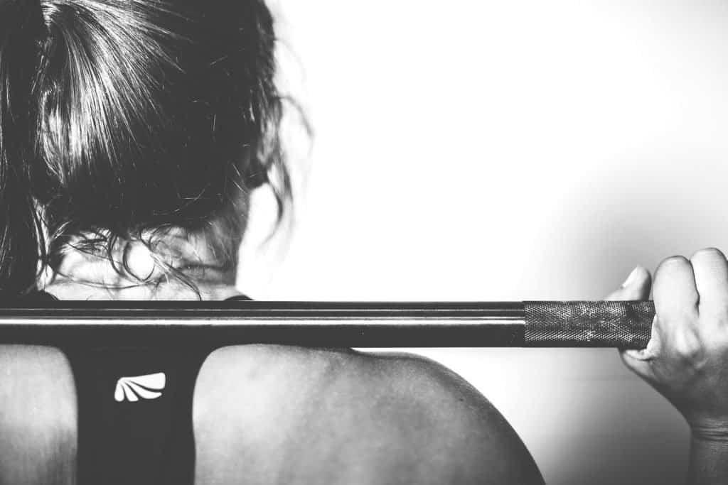 women lifting weights alone