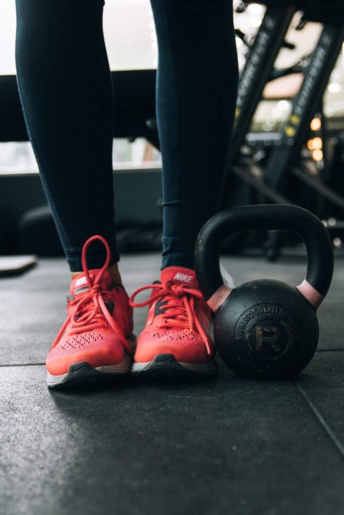 woman working out with kettlebell alone