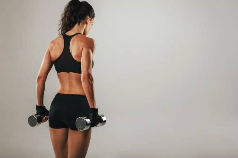 woman strength training with dumbbells