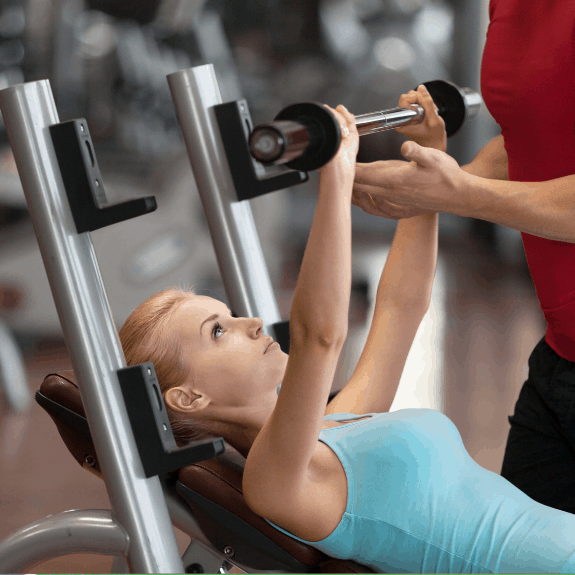 woman strength training chest press