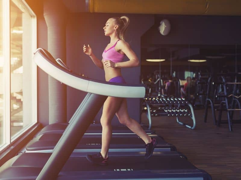girl running on treadmil